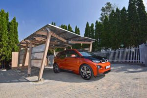 BMW parked under solar power units
